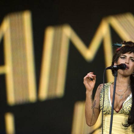 """FILE - In this file photo dated Friday, July 4, 2008, Jazz Soul singer Amy Winehouse, from England, performs during the Rock in Rio music festival in Arganda del Rey, on the outskirts of Madrid. A new movie entitled """"Amy"""" directed by Asif Kapadia, is scheduled for release on Friday July 3, 2015. Critics love the movie and top performers sing the praises of the late Amy Winehouse, but the singer's father, Mitch Winehouse, says the film has been edited to depict the family as doing too little to help the ephemeral Amy Winehouse overcome addiction.(AP Photo / Victor R. Caivano)"""